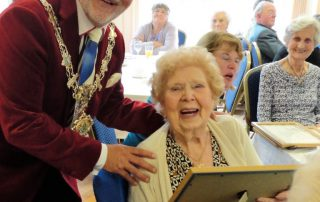 Mayor of fylde john singleton presents certificate to Ivy Broadbent