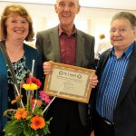 Talking Newspaper long service volunteers Tony and Susan Court with comedian Johnnie Casson